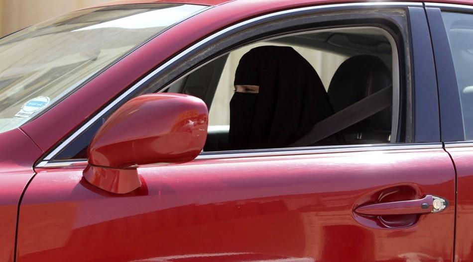 A female driver defies the ban in Saudi Arabia.