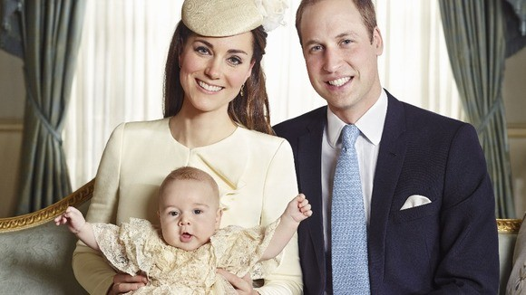Kate Middleton and Prince William with their son Prince George. This image is one of the four official photographs of Prince George on his Christening day. (Credit: Jason Bell/CAMERA PRESS)