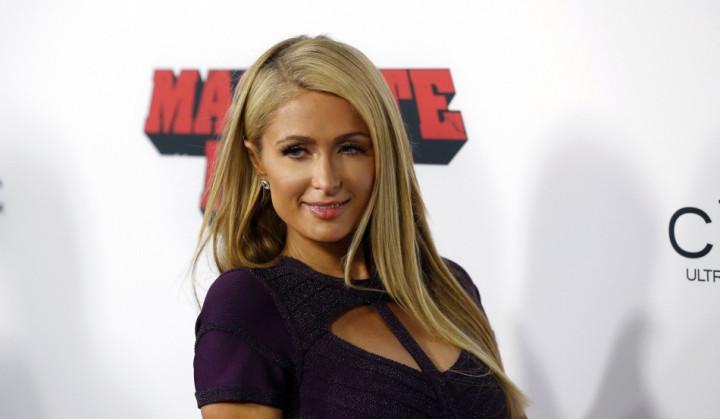 Socialite Paris Hilton poses at the premiere of
