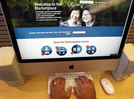 A man looks over the Affordable Care Act (commonly known as Obamacare) signup page on the HealthCare.gov website in New York in this October 2, 2013 photo illustration.