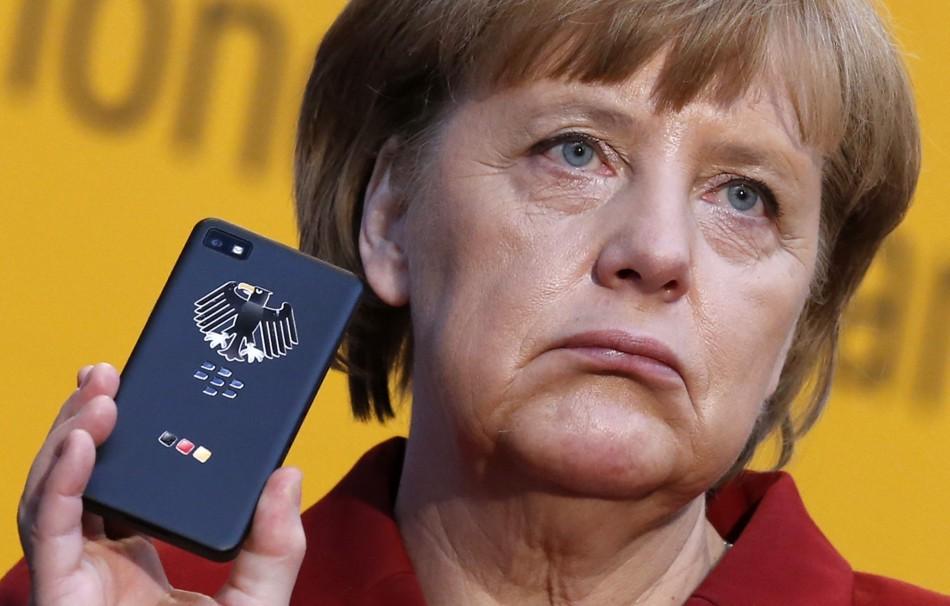 German Chancellor Merkel holding a smartphone