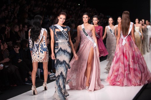 Olga Storozhenko, Miss Universe Ukraine 2013; Karen Ghrawi, Miss Universe Lebanon 2013; and Elmira Abdrazakova, Miss Universe Russia 2013; walk the runway at the Tony Ward Fashion Show on October 26, 2013 during Mercedes Benz Fashion Week in Moscow, Russi