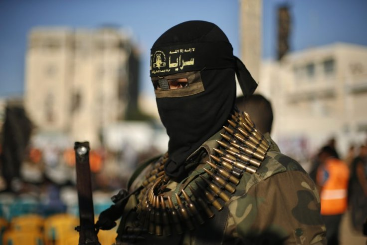 A Palestinian militant stands guard during anti-Israeli rally organized by Islamic Jihad movement in Rafah
