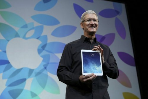 Apple Inc CEO Tim Cook Holds up the New iPad Air During an Apple Event in San Francisco, California
