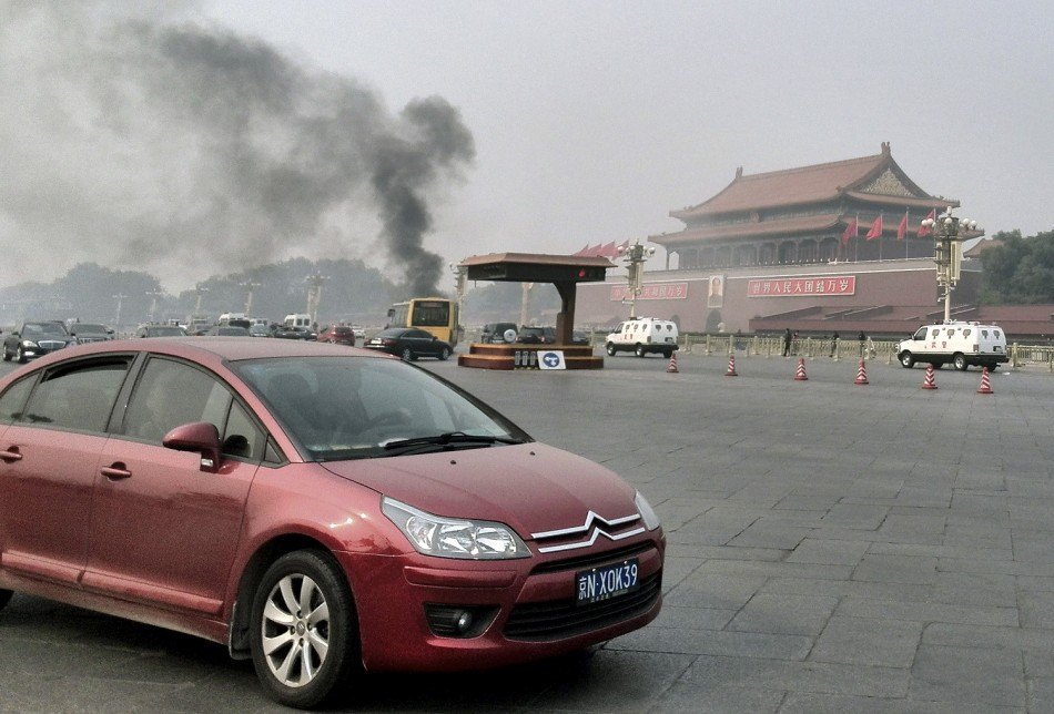 smoke raises in front of the main entrance of the Forbidden City at Tiananmen Square