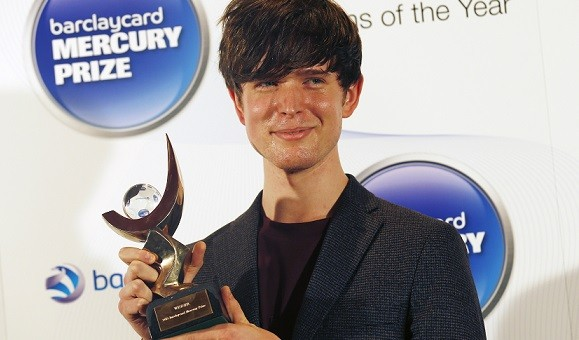 James Blake, winner of the 2013 Mercury Music Prize, poses for a photograph after the ceremony in north London (Reuters)