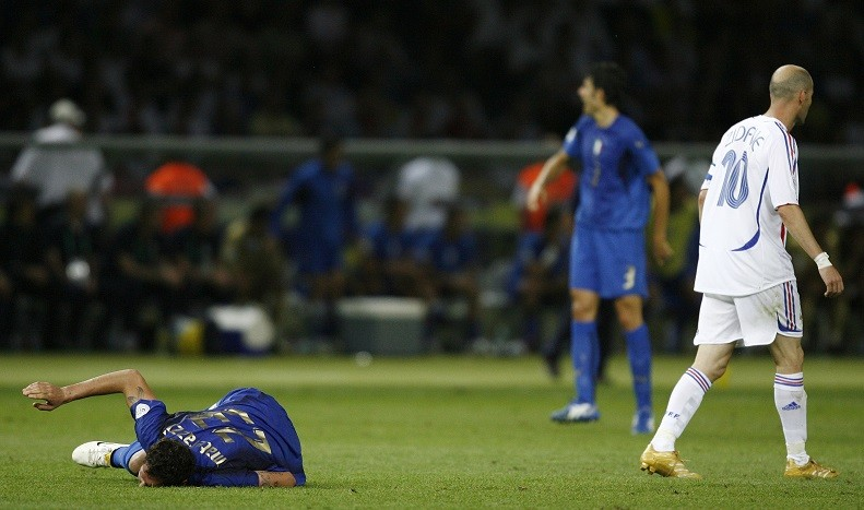 Zidane (walks away after headbutting Italy's Marco Materazzi during their World Cup 2006 final (Reuters)