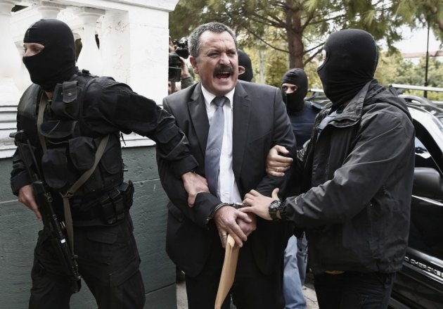 Extreme-right Golden Dawn party senior lawmaker Christos Pappas is escorted by anti-terrorism police officers to a courthouse in Athens