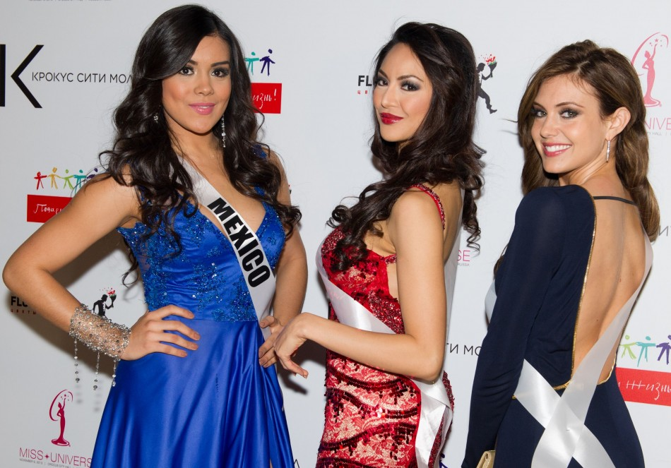 Cynthia Duque, Miss Universe Mexico 2013; Riza Santos, Miss Universe Canada 2013; and Erin Brady, Miss USA 2013; pose for a photo during arrivals for the National Gift Auction at Crocus City Mall on October 30, 2013. (Photo: MIss Universe Organization L.P
