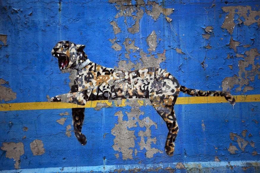 A big cat mural by Banksy is the penultimate piece of the UK artist's residency in New York PIC: Reuters