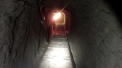 The tunnel, complete with rail line, was described as a 'highly sophisticated' underground passageway (Reuters)