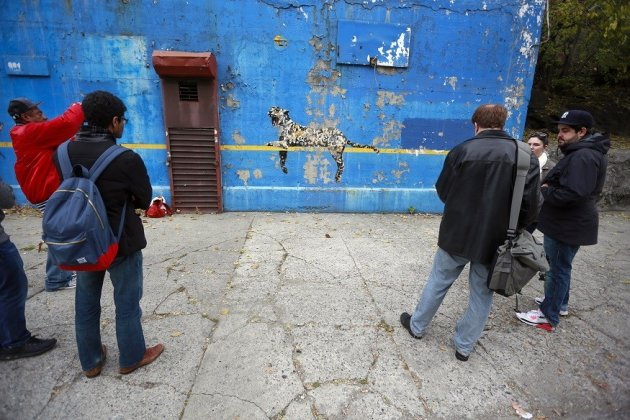 Spectators gather to check out Bronx Zoo by Banksy near the New York Yankees stadium PIC: Reuters