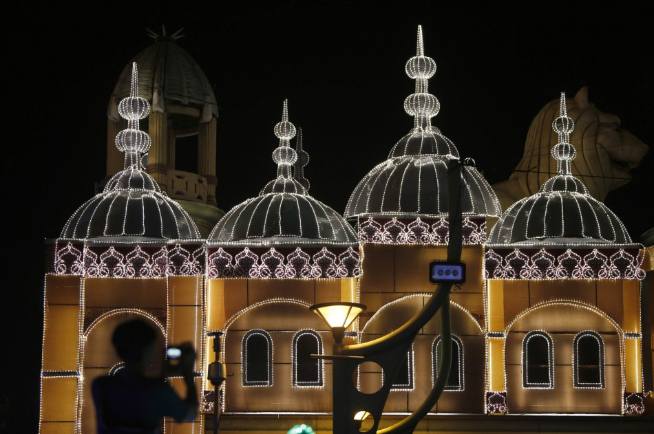 A man takes pictures of light decorations before upcoming Diwali celebrations in Kuala Lumpur