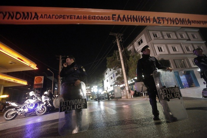 Police outside Golden Dawn office where two members were killed.