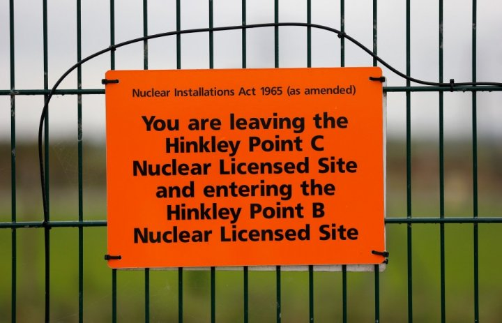 A sign marks the borders of the site where EDF Energy's Hinkley Point C nuclear power station will be constructed in Bridgwater, southwest England