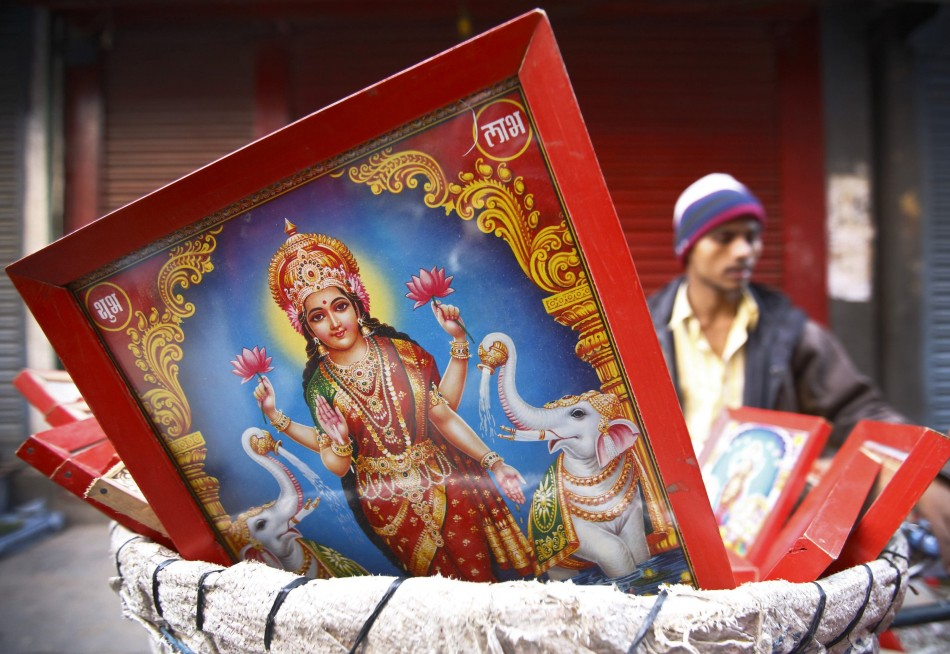 A poster of the Goddess of wealth Laxmi is seen for sale by a vendor along the streets of Kathmandu during the Tihar festival also called Diwali in Kathmandu. (Photo: Reuters)