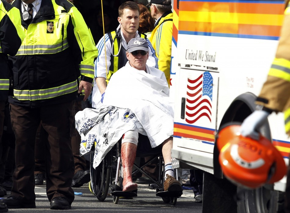 Alicia Ann Lynch, dressed up as a Boston Marathon bombing victim, to her office Halloween party. Here, a runner in a wheelchair is taken from a triage tent after explosions went off at the 117th Boston Marathon in Boston, Massachusetts April 15, 2013. (Re