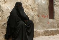 A woman sits in an alley in the Old City of Ibb, the provincial capital of Yemen's central province of Ibb. Yemen is the most unfair country for women, a new report suggests. (Photo: REUTERS)