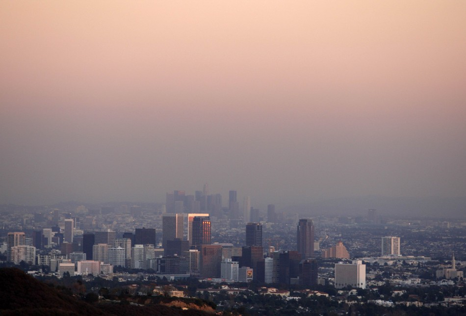 Century City and downtown Los Angeles are seen through the smog in this December 31, 2007 file photo. The air we breathe is laced with cancer-causing substances and should now be classified as carcinogenic to humans, the World Health Organization's cancer