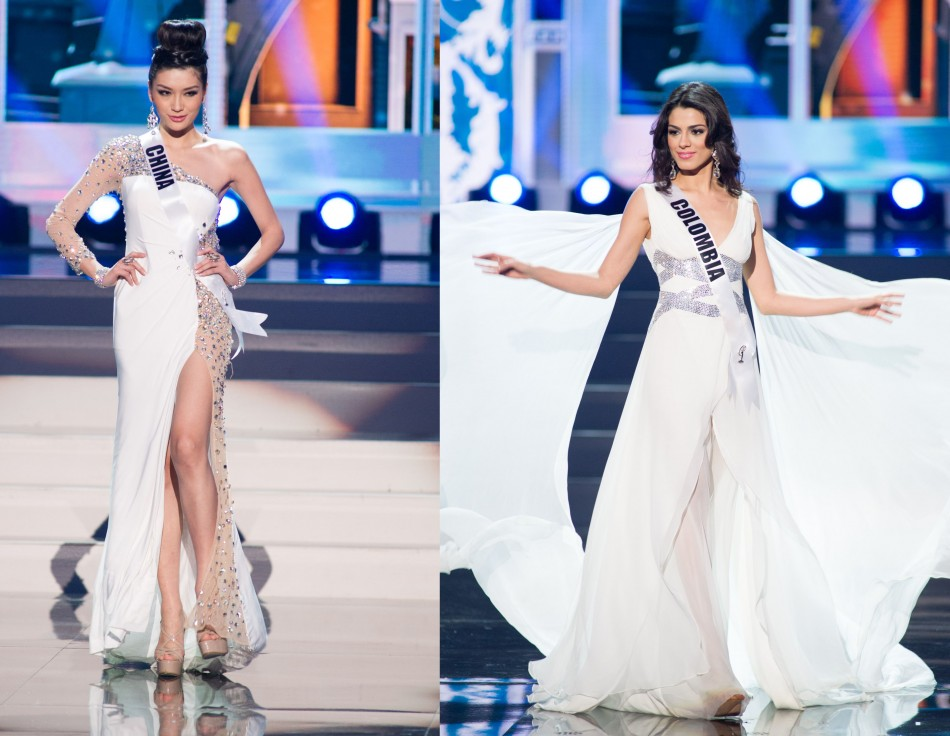 Vision in white: Miss Universe China and Colombia. (Photo: Miss Universe L.P., LLLP)
