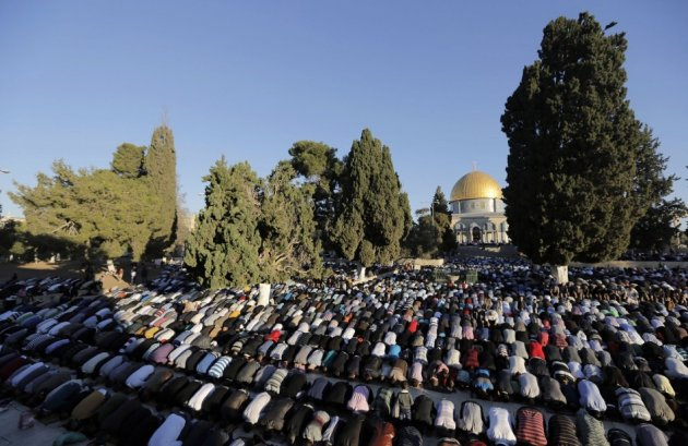 Palestinians pray in front of the Dome of the Rock on the compound known to Muslims as al-Haram al-Sharif and to Jews as Temple Mount in Jerusalem's Old city,
