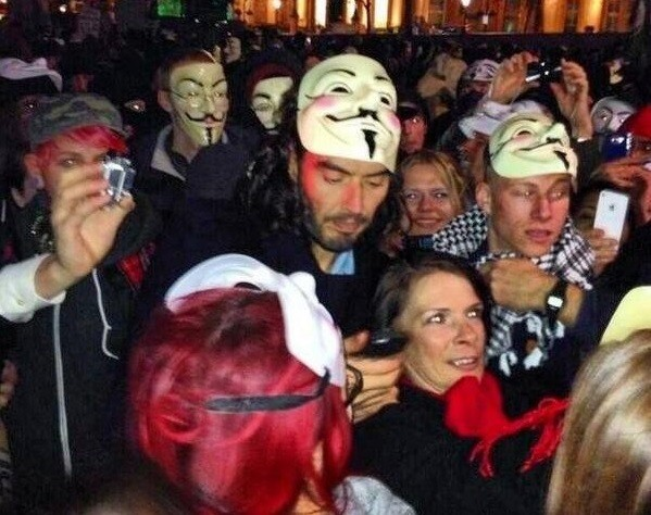 Russell brand with a mask of Guys Fawkes - who tried to destroy parliament PIC: @SpaceMonkey0000