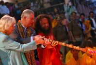 Prince Charles and his wife Camilla, Duchess of Cornwall, perform a ritual as part of an Aarti ceremony at Parmarth Miketan Temple on banks of river Ganges in Rishikesh. (Photo: Reuters)