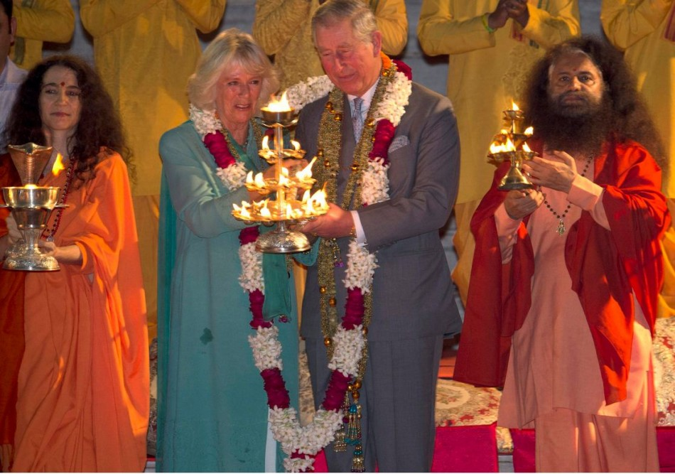 Charles and Camilla perform Aarti along with Indian sages on the banks of Ganges river. (Photo: Reuters)