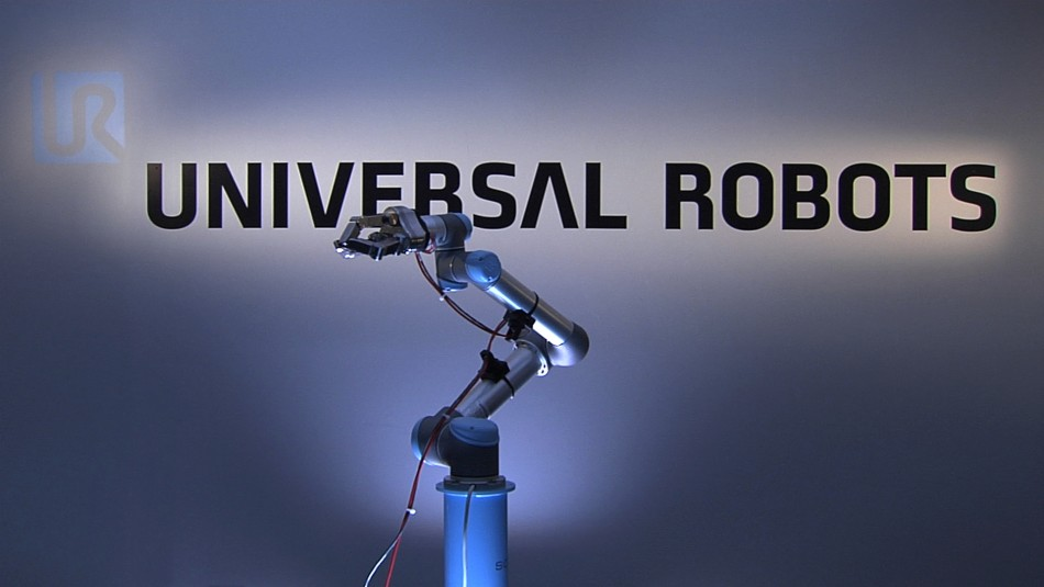 To mark the launch of a new robotics stock index, ROBO-STOX, on the Nasdaq a Universal Robots' UR5 robot arm, with an integrated three fingered SDH gripper, will reach up and ring the closing bell. (Photo: Universal Robots on YouTube)
