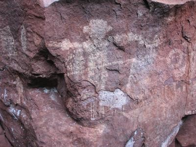 Human-like figure and symbols drawn on rock. (Photo: Alexine Keuroghlian/WCS)