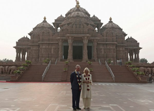 Prince Charles and Camilla pose in front of the Hindu temple Akshardham during their visit to the temple in New Delhi. (Photo: Reuters)