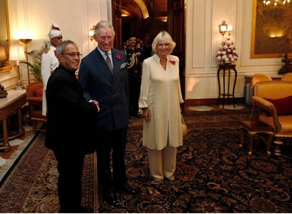 Prince Charles shakes hands with India's President Mukherjee before their meeting in New Delhi. (Photo: Reuters)