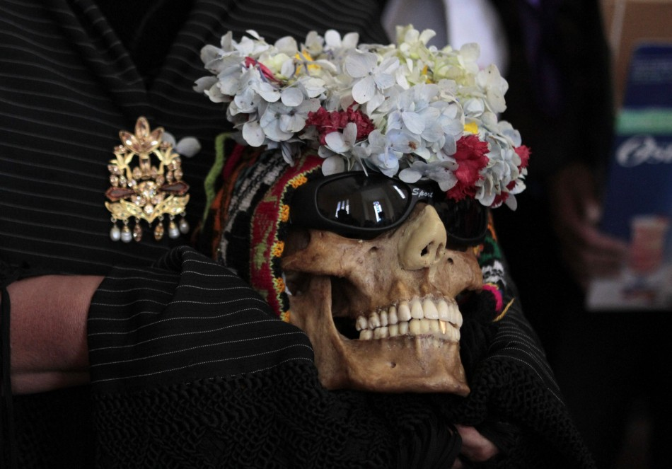 The  skulls are adorned with garlands of flowers and sometimes sunglasses.
