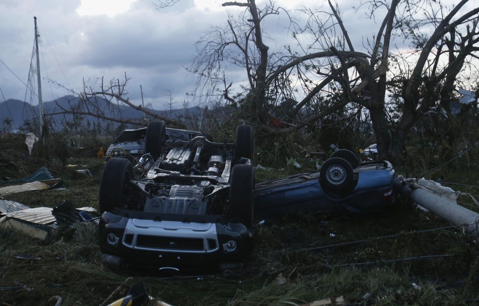 overturned vehicles outside Tacloban airport after Hurricane Haiyan battered the Phillipines.