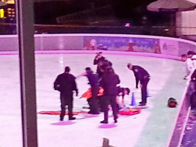 Police attend to a victim of the ice skating story. (Twitter: Raghuram Krishnamachari)