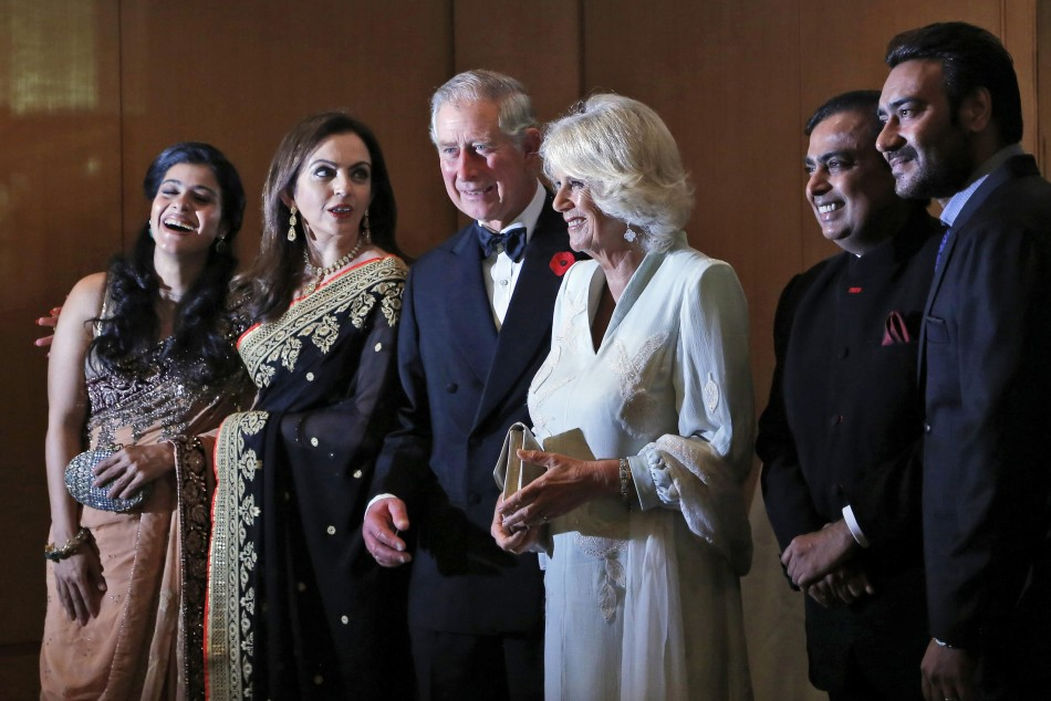 Britain's Prince Charles and his wife Camilla, stand with Nita Ambani, Kajol, Mukesh Ambani and Ajay Devgan before a dinner to support the work of British Asian Trust in Mumbai
