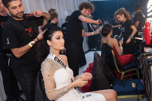 Jin Ye, Miss Universe China 2013, gets her hair done by CHI artist, Wajid Khan, backstage during Miss Universe 2013 pageant.  (Photo: Miss Universe L.P., LLLP)