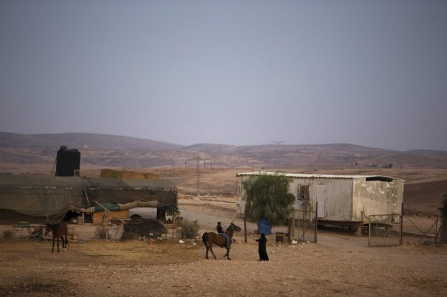 A Bedouin rides a horse in the village of al-Arakib, one of the dozens of ramshackle Bedouin Arab communities in the Negev desert which are not recognised by the Israeli state, in southern Israel