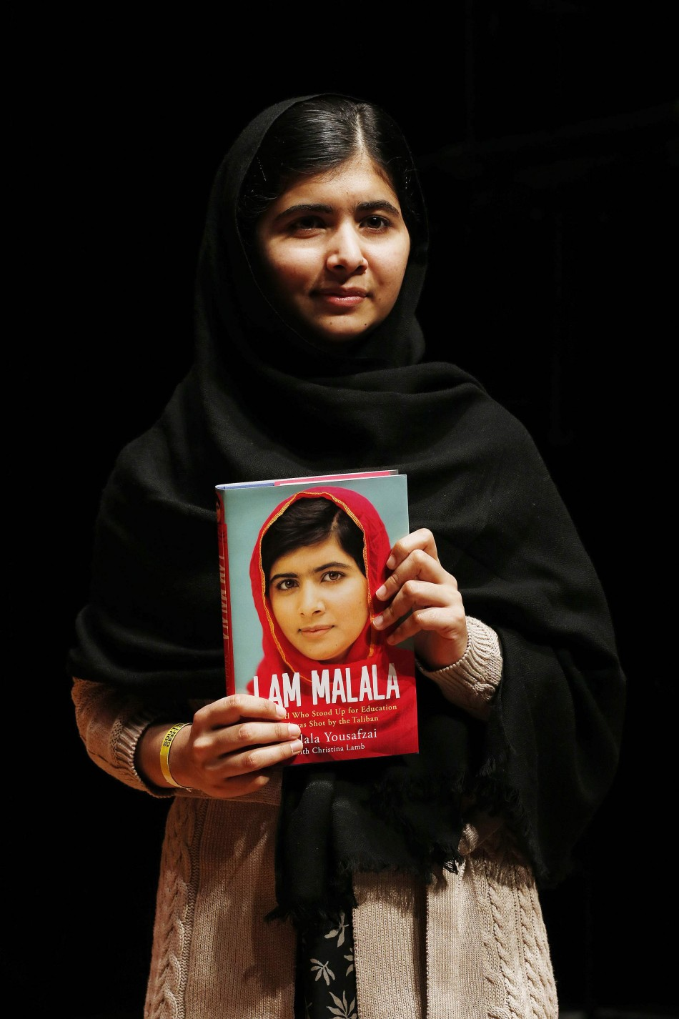 Pakistani teenage activist Yousafzai poses for pictures before an event launching her memoir