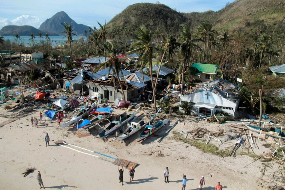 An aerial view shows damaged houses, as residents wave for help after Typhoon Haiyan hit a village in Panay island, in northern Iloilo Province. (Photo: REUTERS/Erik De Castro)