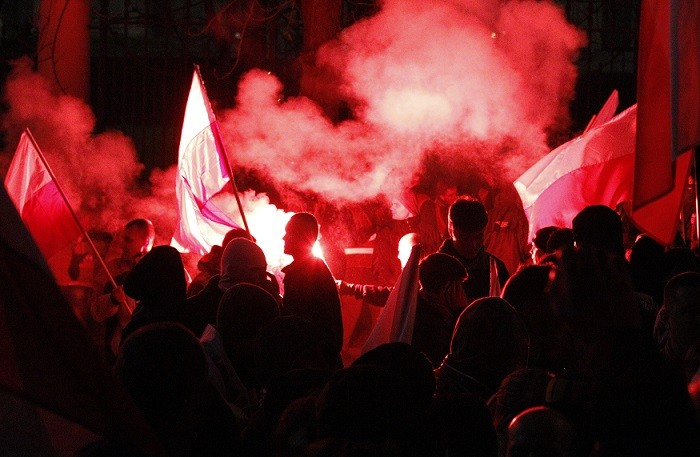 Protesters in front of the building of Russian embassy during the annual far-right march, which coincides with Poland's national Independence Day (Reuters)