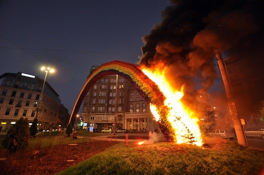 A  rainbow-coloured arch symbolising tolerance was also burned in the violence (Reuters)