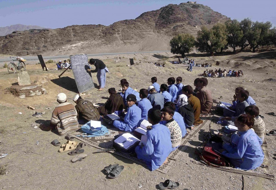 Afghan children study at an open area on the outskirts of Jalalabad province November 11, 2013
