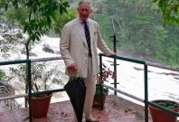Prince Charles poses for pictures against the backdrop of Vazhachal waterfalls at Thrissur district in Kerala. The prince of Wales turned 65 on 14 November. (Photo: Reuters)