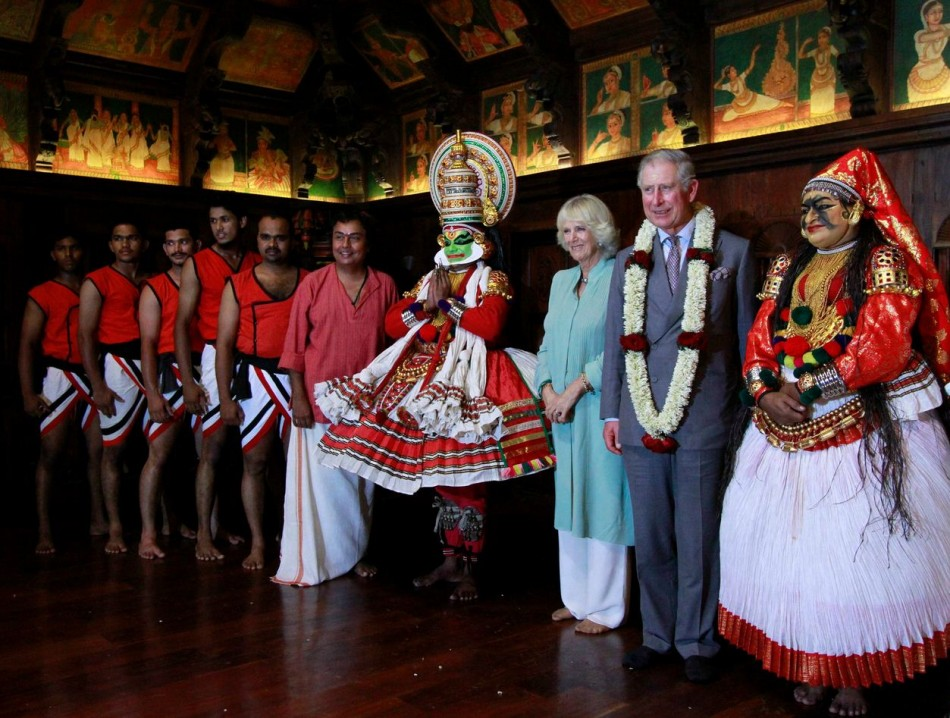 Prince Charles and Camilla pose with artists after watching their performance at the Kerala Folklore Museum and Theatre in Kochi. (Photo: Reuters)