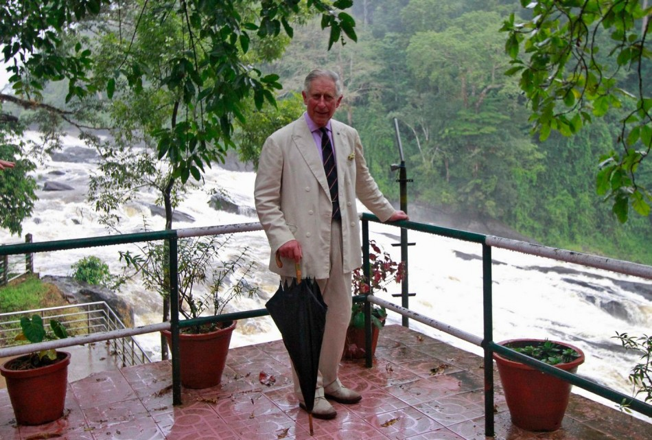 Prince Charles poses for pictures against the backdrop of Vazhachal waterfalls at Thrissur district in Kerala. (Photo: Reuters)