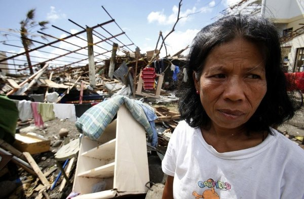 Woman Ponders Typhoon Haiyan Damage