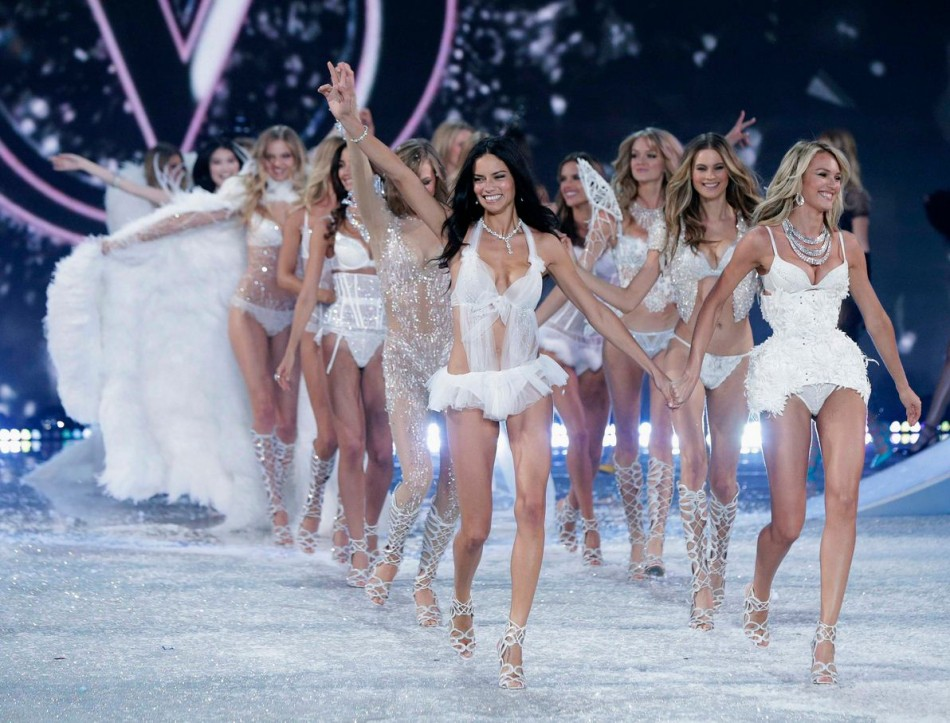 Models summed off the show with all-white ensembles and feather wings. (Photo: Reuters/Lucas Jackson)