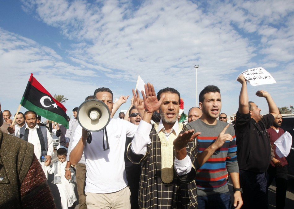 Protesters march during a demonstration calling on militiamen to leave, in Tripoli