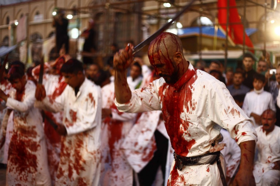 Iraq Shi'ite Muslim men bleed as they gash their foreheads with swords and beat themselves during the religious festival of Ashura in Najaf, 160km (100 miles) south of Baghdad. (Photo: REUTERS/Alaa Al-Marjani)